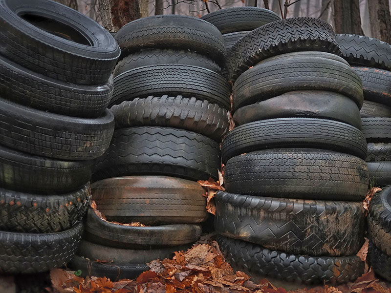 stacks of old tires sitting outdoors