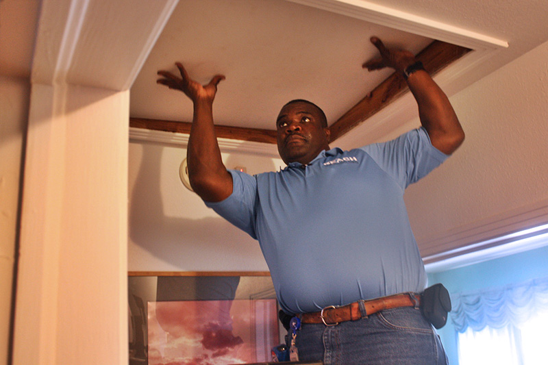 An energy auditor inspects a home to improve energy savings.